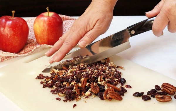 Chopping cranberries and pecans.