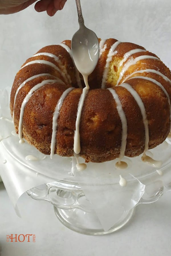 drizzling icing on the bundt cake
