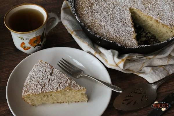 A slice of vanilla skillet cake with tea