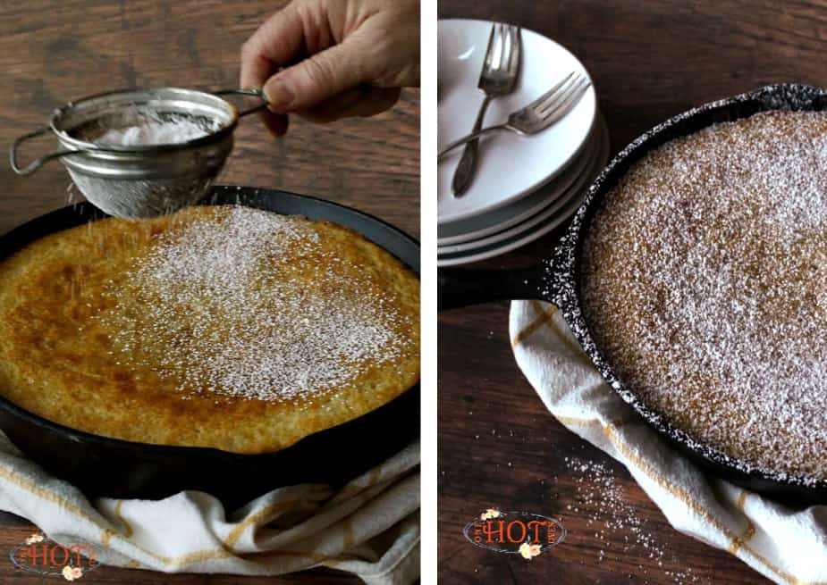 Sprinkling powdered sugar on top of a vanilla skillet cake