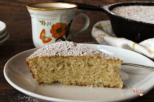 A slice of vanilla cinnamon skillet cake