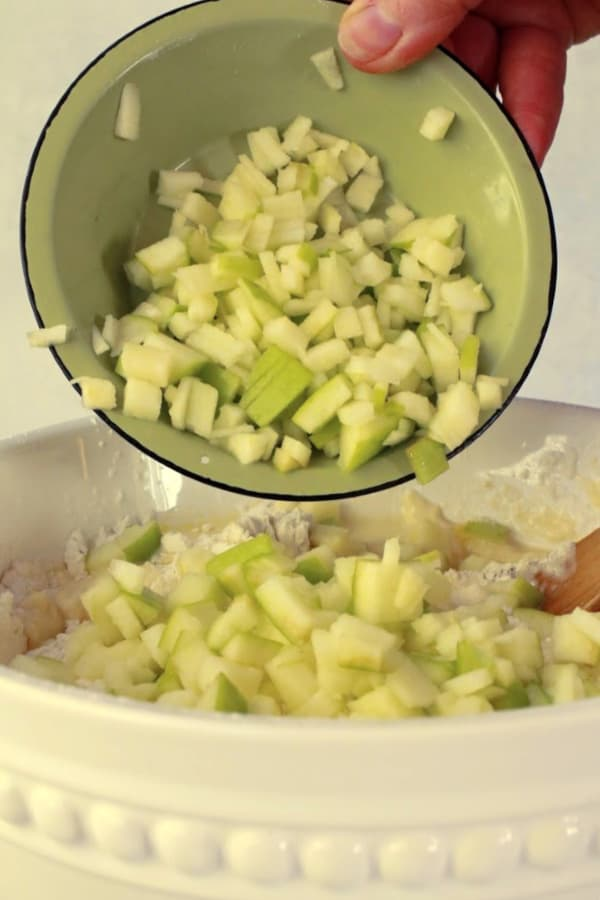 adding chopped apples to the scone batter