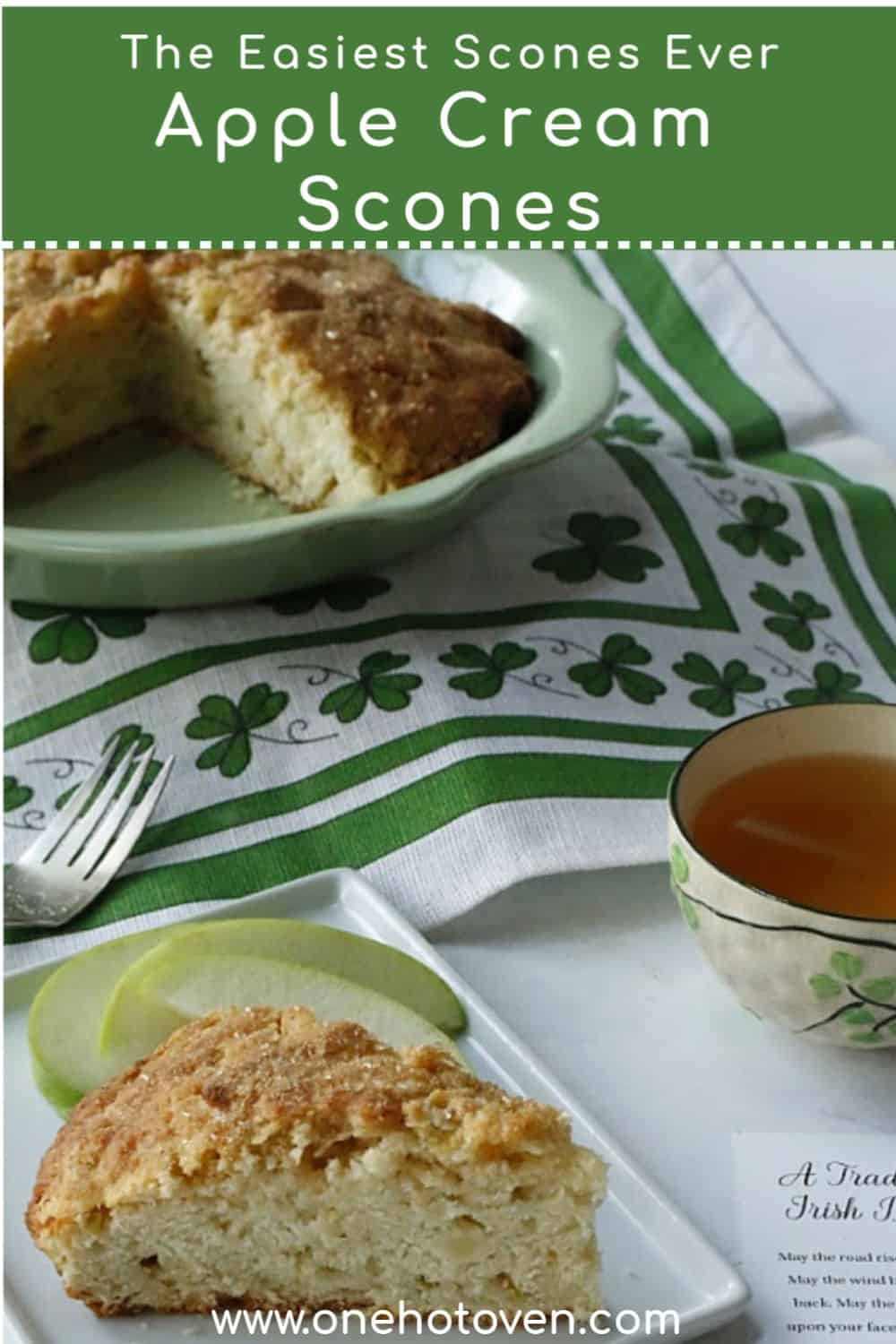 Apple Cream Scones in a baking pan with a cup of tea.