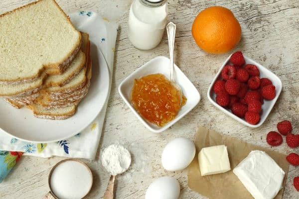 bread, eggs, raspberries, orange, orange jam, butter