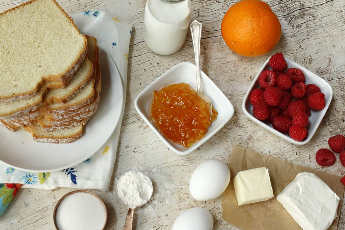 bread, eggs, sugar, orange, cream cheese, butter, flour, orange marmelade