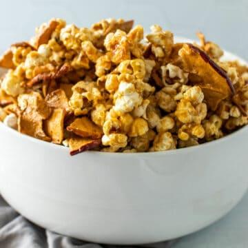 A white bowl full of caramel popcorn