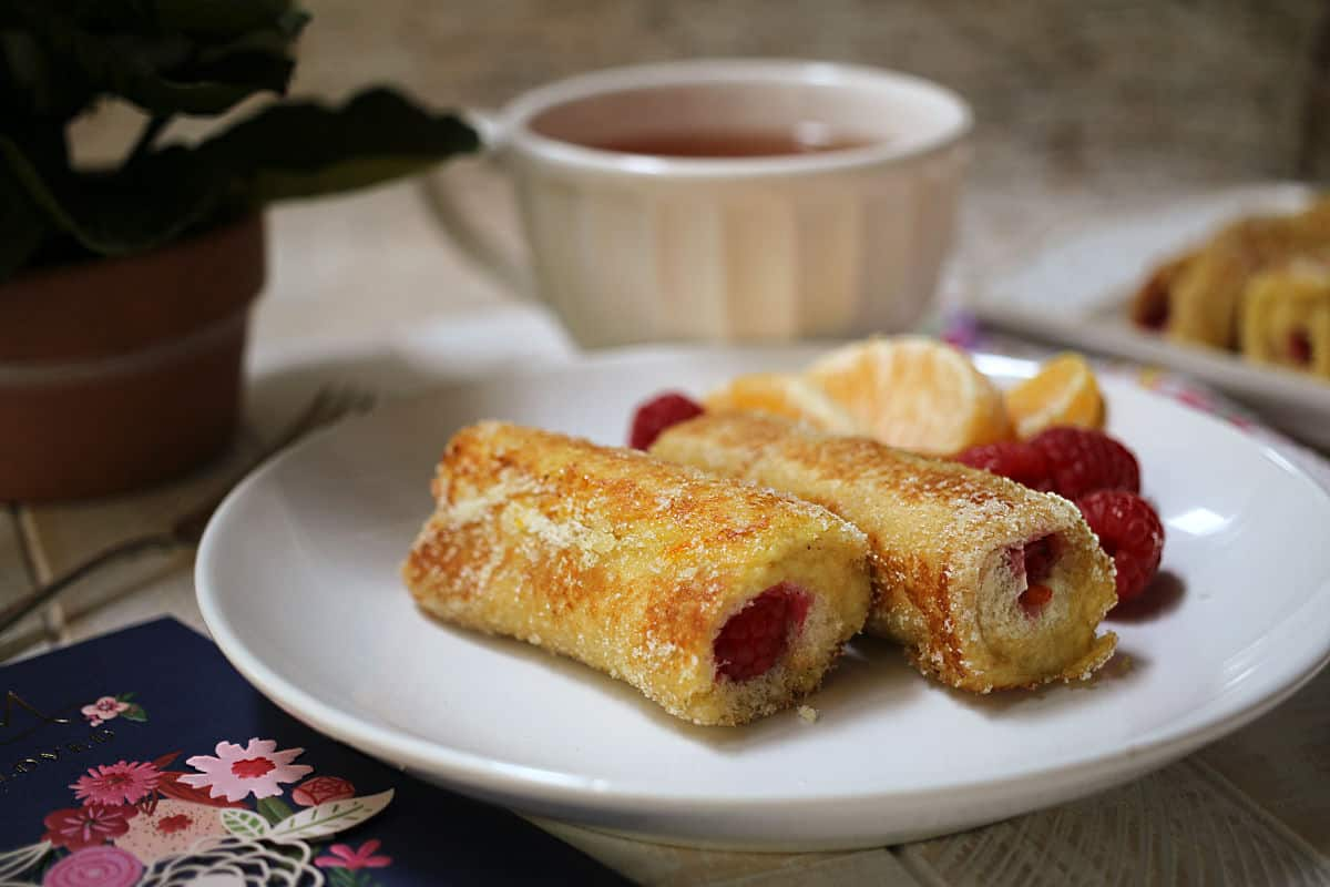 French Toast Rolls on a plate with tea