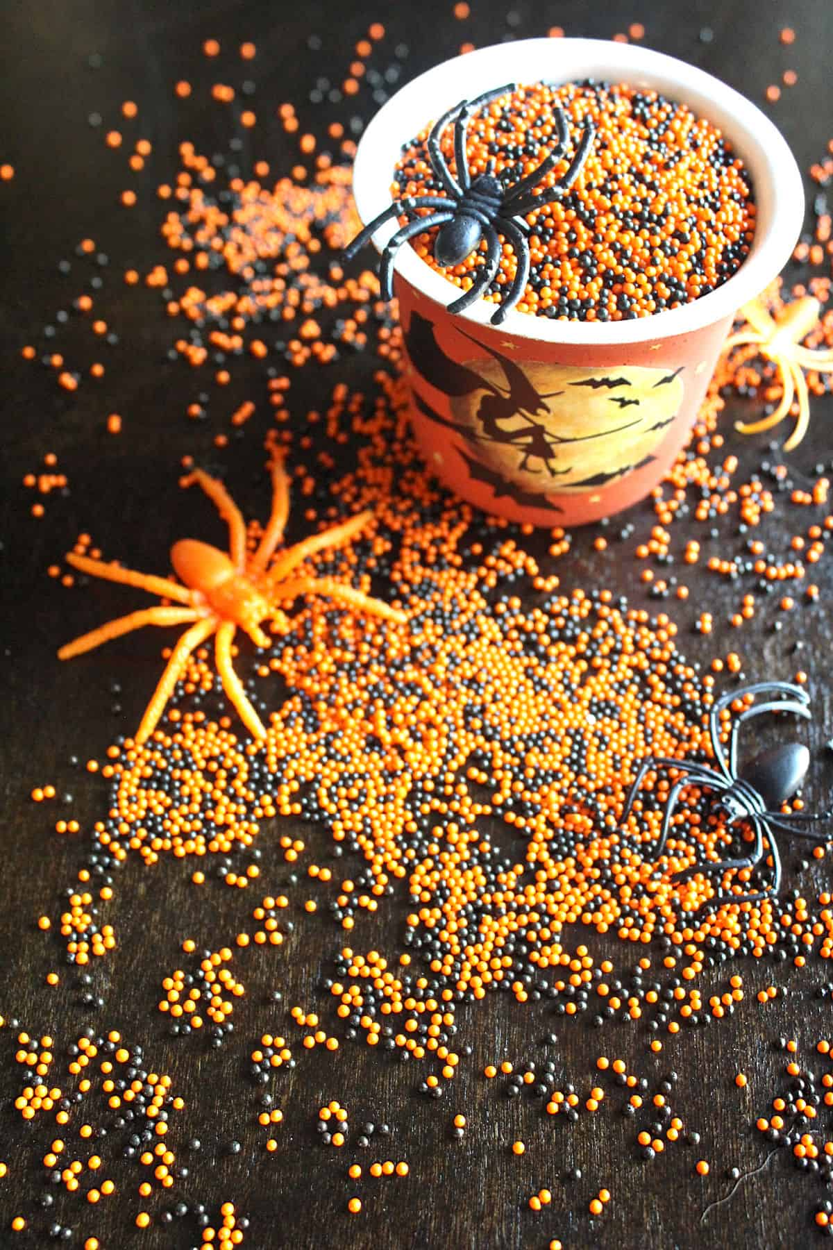 orange and black sprinkles with plastic spiders