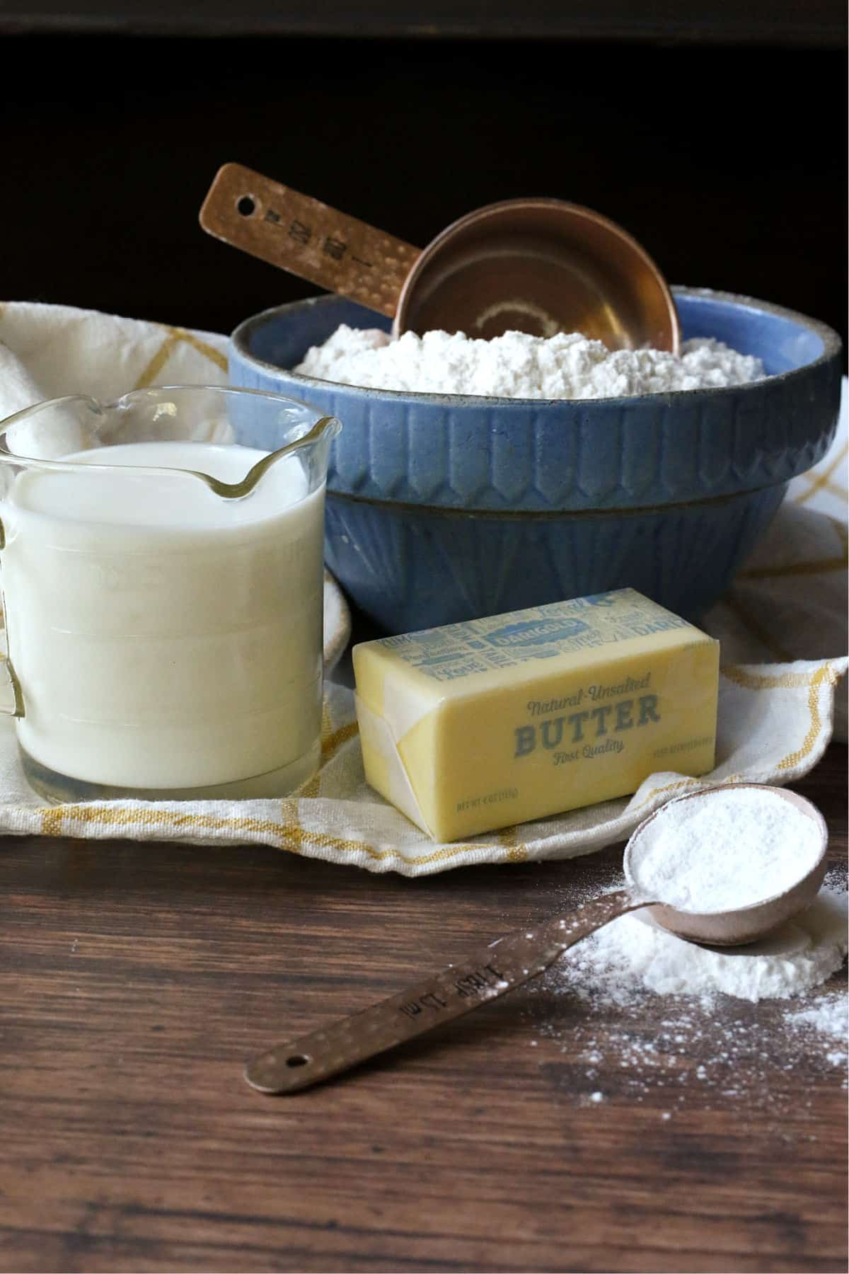 butter, flour, milk and baking powder for biscuits