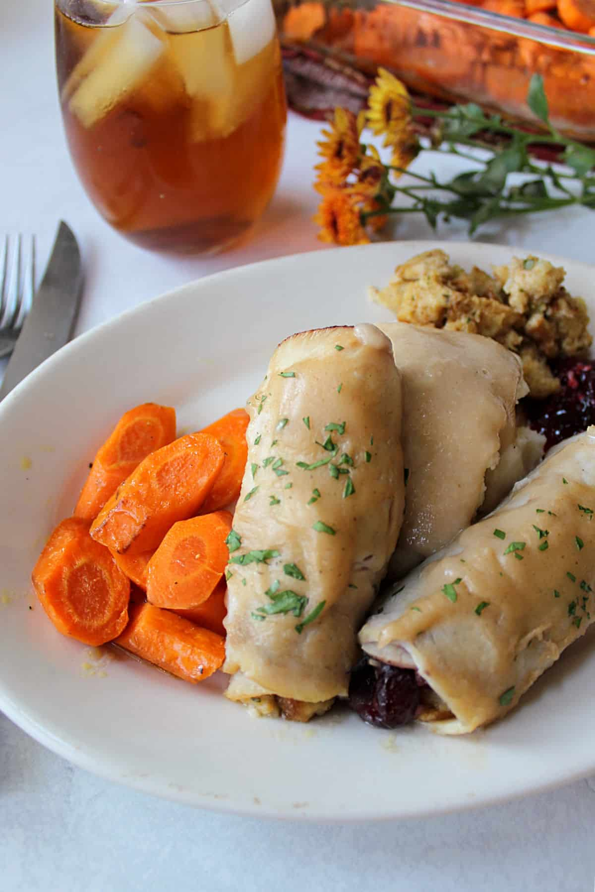 stuffed turkey rolls with gravy, potatoes and carrots