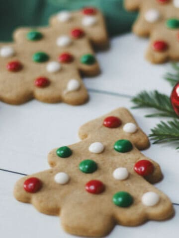Spiced christmas tree cookies with red, green and white icing dots.
