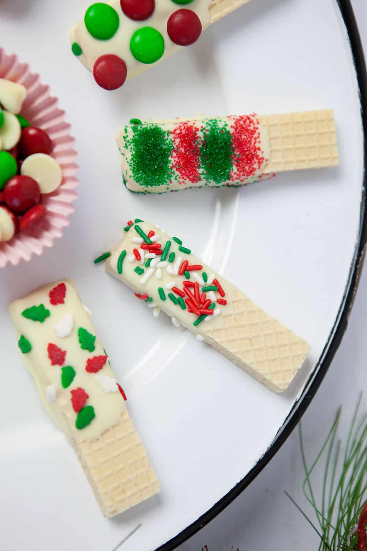 a plate of decorated sugar wafer cookies