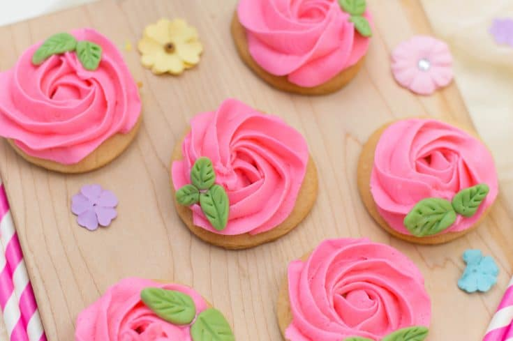 frosted sugar cookies with pink flowers.