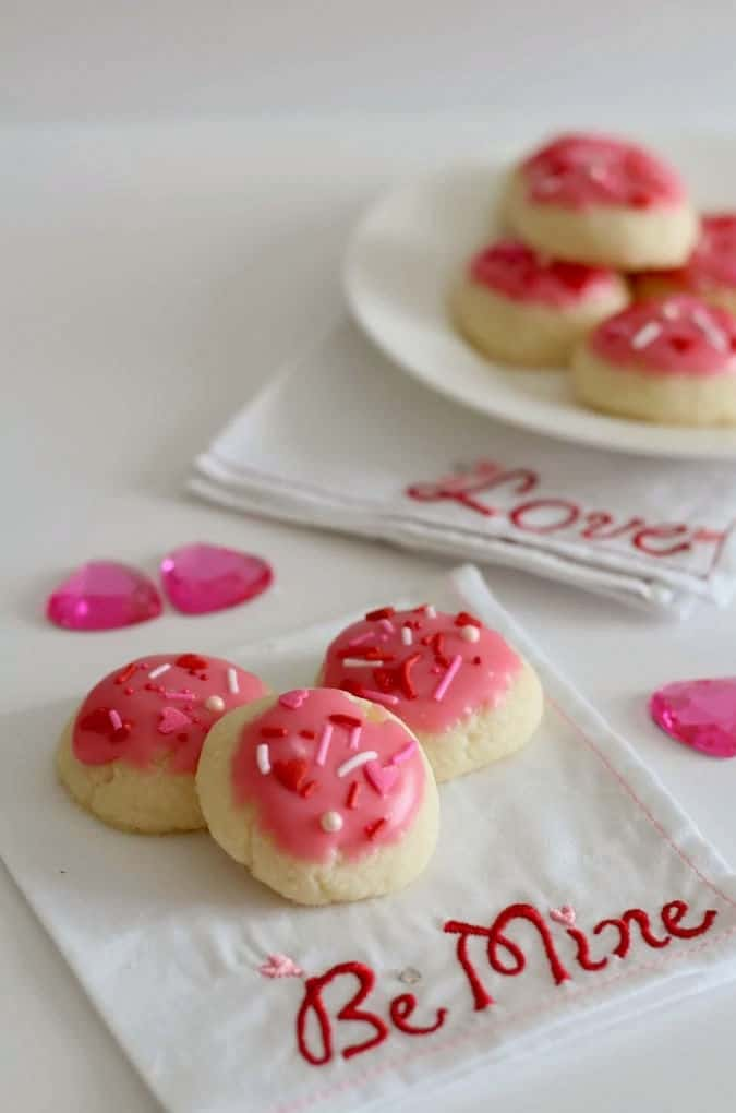 raspberry iced shortbread cookies with sprinkles.