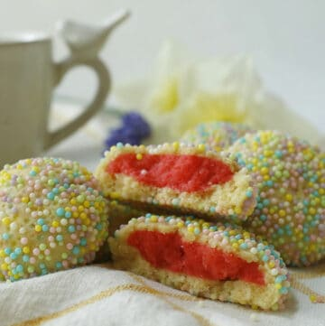 Raspberry Sprinkle Cookies with a cup of tea.