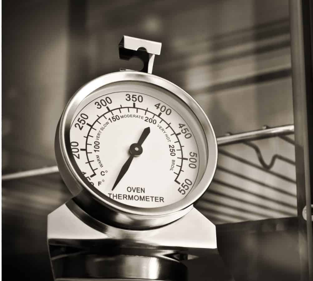 An oven thermometer in the oven.