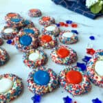 Red, white and blue thumbprint cookies.