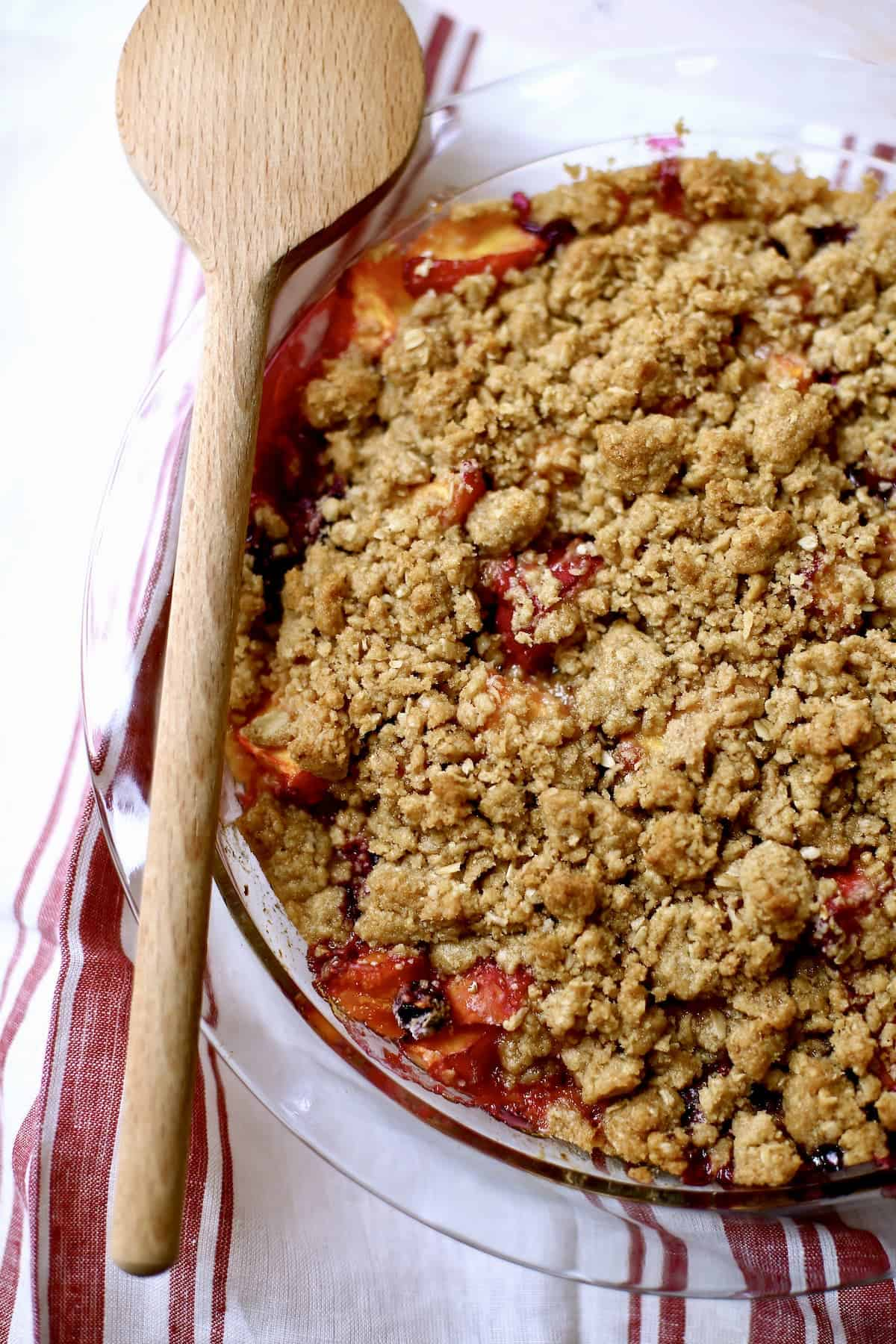 A baking with a baked fruit crisp.