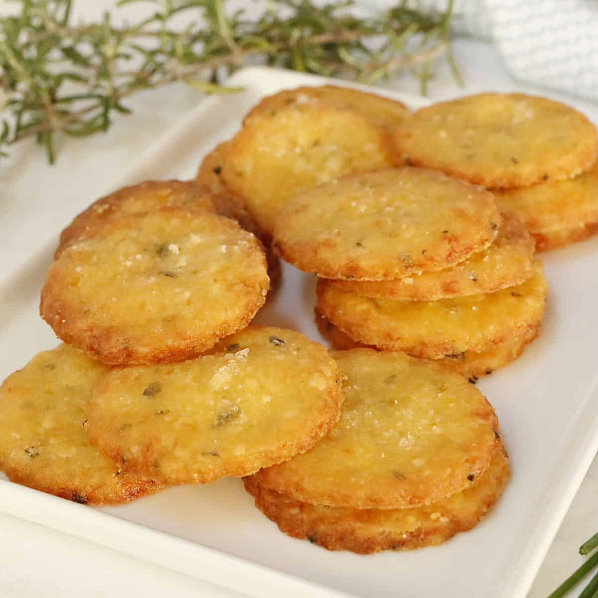 A white tray with baked cheese crackers.