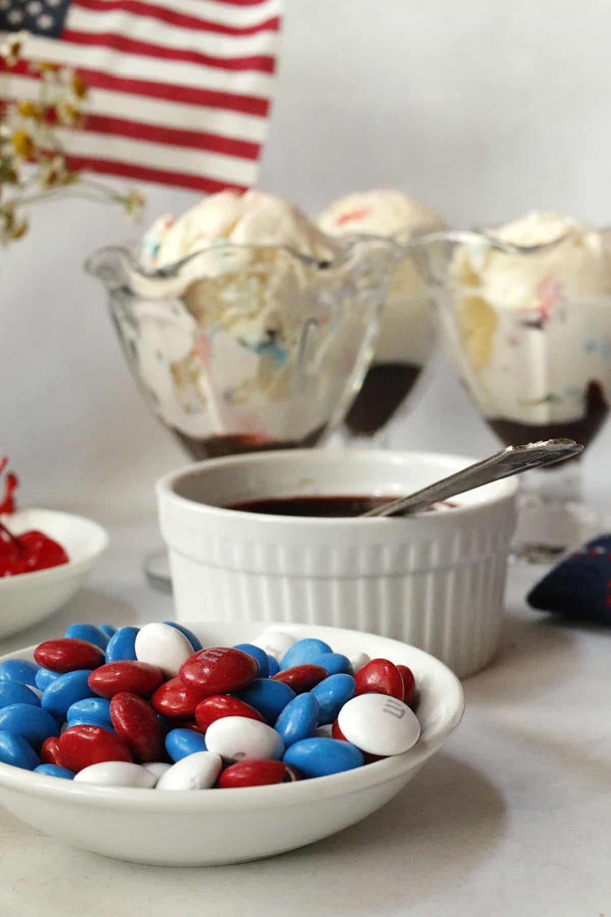 Dessert glasses filled with vanilla ice cream and M&M's