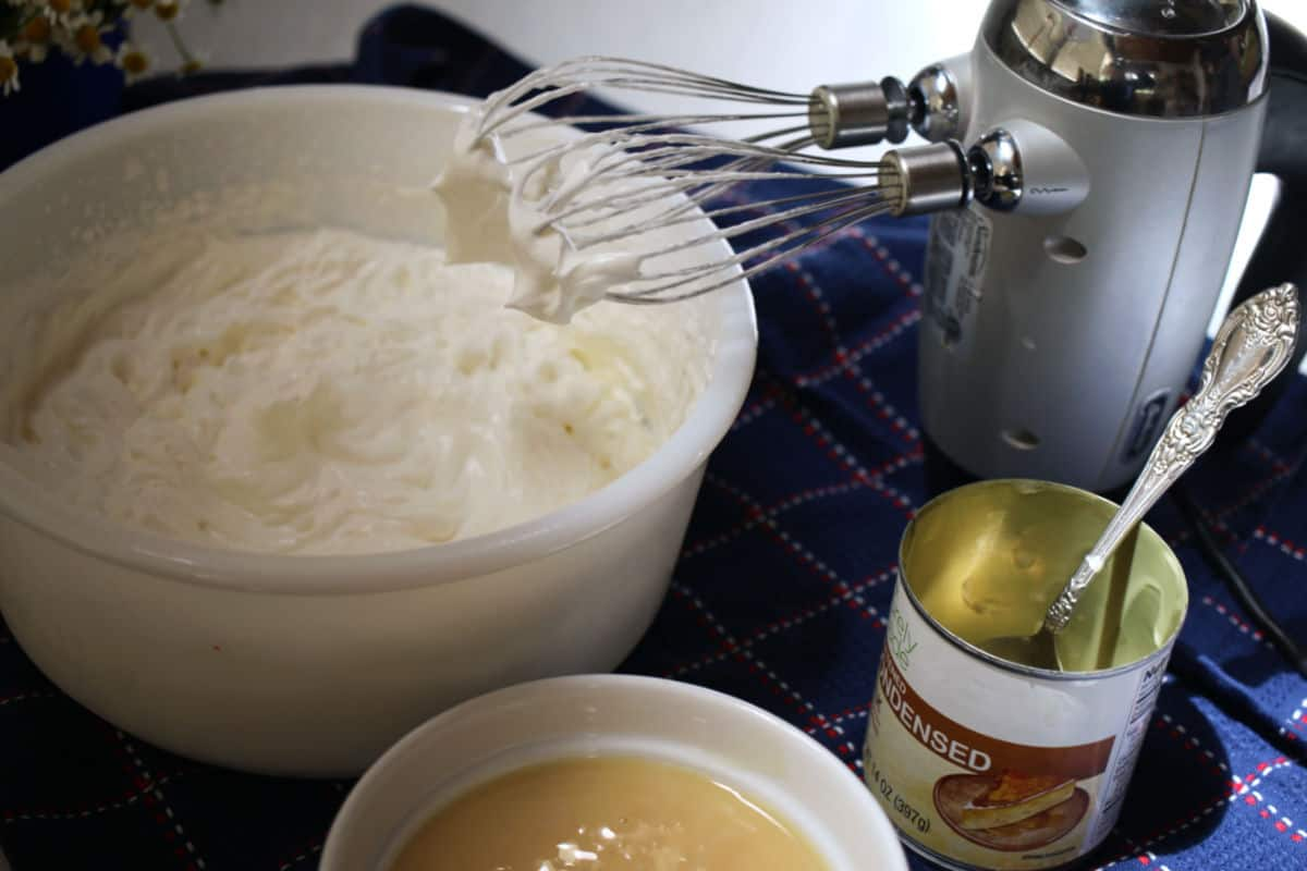 Whipping cream with a mixher.