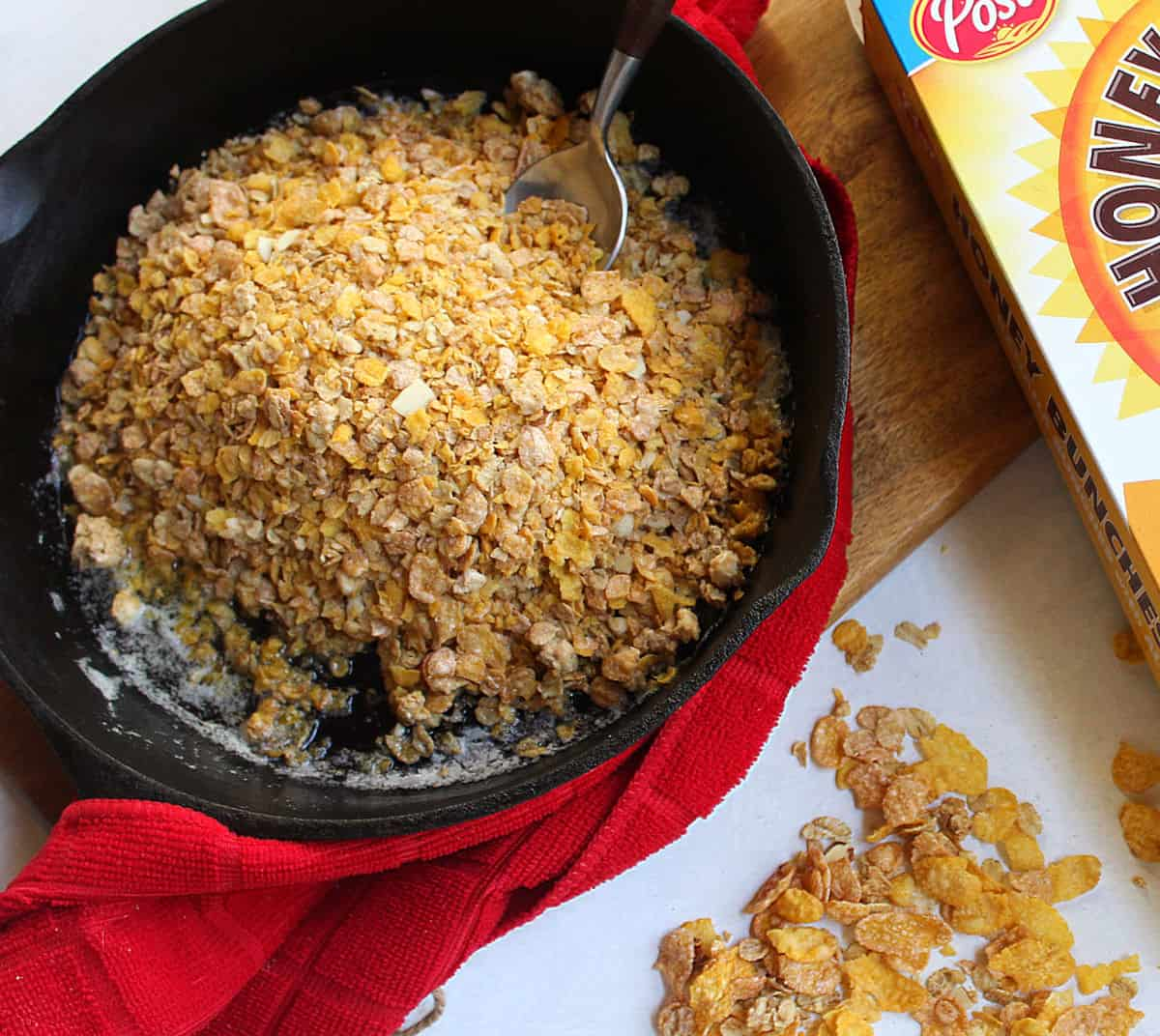 Toasting cereal in melted butter in a cast iron skillet
