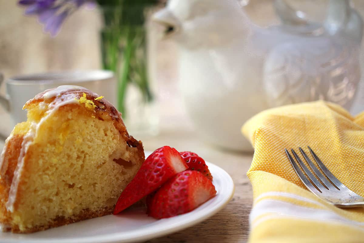 A slice of lemon cake with strawberries