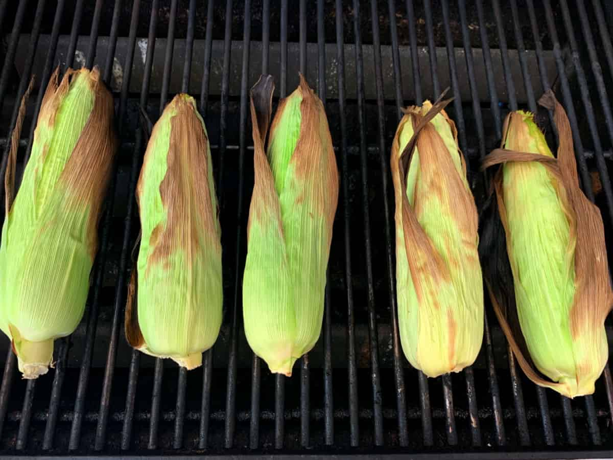 Grilling corn on the cob on a gas grill.